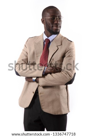 Young and handsome. Handsome young African senegalese man in smart casual jacket holding hands in pockets and traditional smiling while standing against white background #1336747718