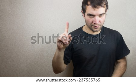 young and handsome man pointing up with his finger
