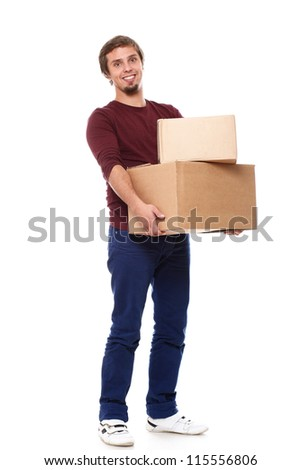 Young and happy guy with cardboard boxes over white background