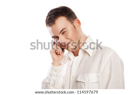 Young and healthy man smiling and talking on phone over white background
