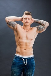 Young and healthy man topless show six pack abs. Handsome male bodybuilder, fitness model