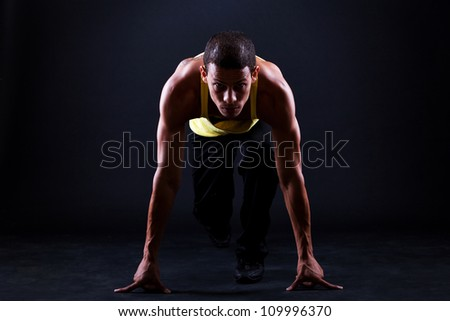 Young and muscular hispanic man is ready for run