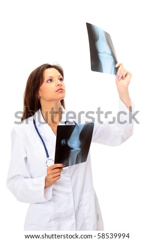 young and nice doctor watching a patient x-ray in hospital