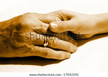 Young and old hand together