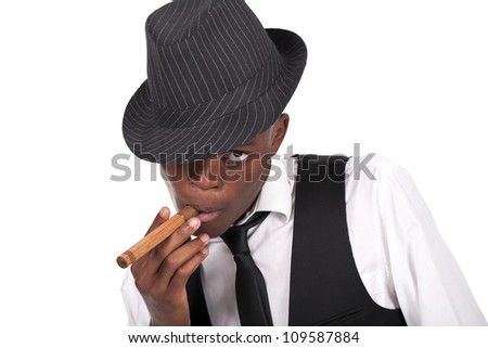 young and sexy black man wearing a hat and smoking a cigar