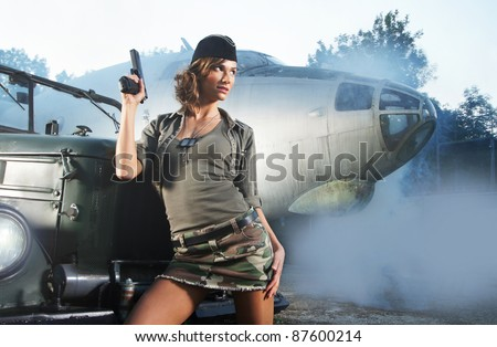 Young and sexy female soldier