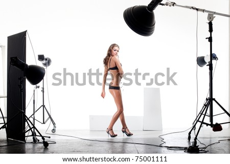 Young and sexy model posing in professionally equipped studio