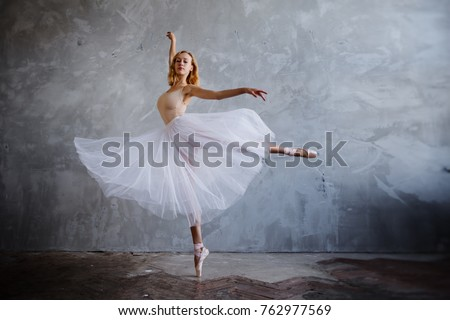 Young and slim ballet dancer is posing in stylish studio with big windows #762977569