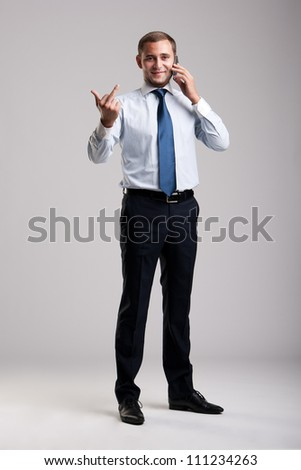 Young and successful businessman holding a smartphone