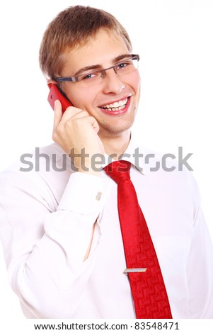 Young and successful businessman with smile uses cell phone