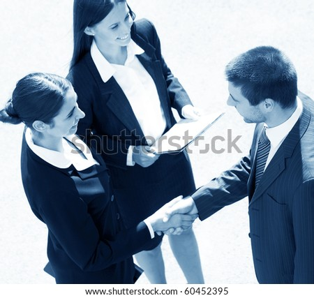 Young and successful businesspeople shake hands