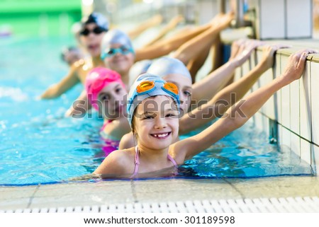 young and successful swimmers pose #301189598