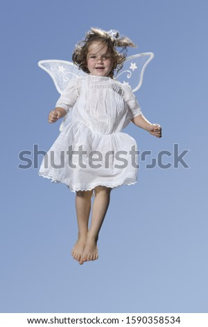Young angel girl in mid air