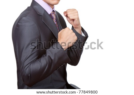 Young angry businessman showing his fists ready to fight.. Ready, concentration, challenge, conflict, anger concept. Isolated over white background.