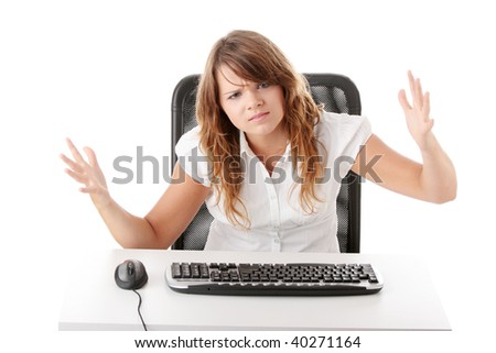 Young angry woman and her PC, isolated on white background