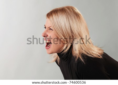 Young angry woman screaming - stock photo