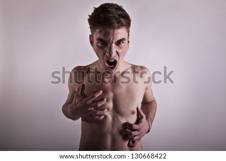 young angry young man with chest and no clothes