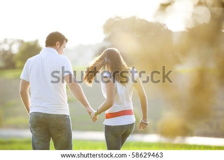 Young anonymous couple taking a walk on nature