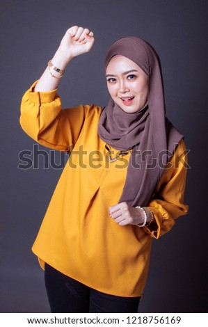 Young arab woman wearing hijab happy and excited expressing winning gesture. Successful and celebrating victory, triumphant #1218756169