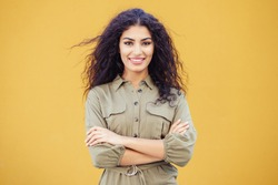 Young Arab Woman with curly hair in urban background
