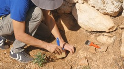 Young archeologist works on an archaeological site