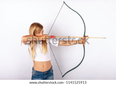 Young archer girl targeting with bow and arrow