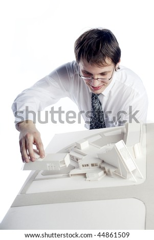 young architect making arcitectural model