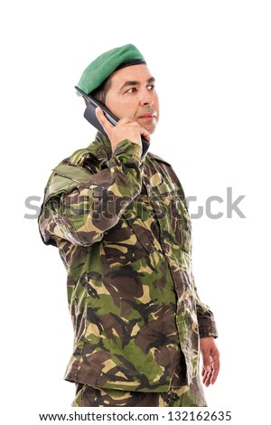 Young army soldier with beret speaking on phone isolated on white background