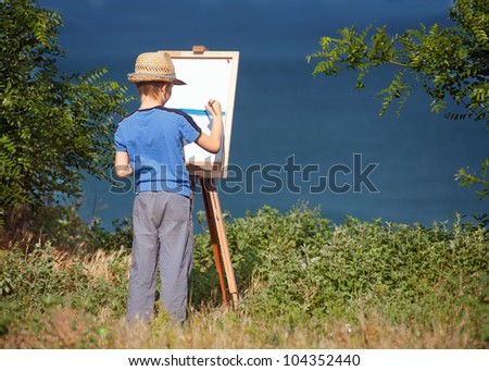 Young artist starting his work, outdoor - stock photo