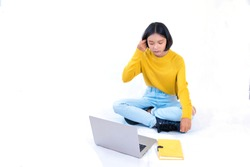 young asia girl sitdown with notebook and laptop with white background.
