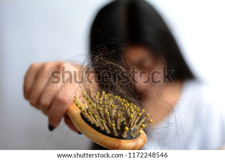 Young asia woman having serious hair loss, hair fall everyday serious problem.