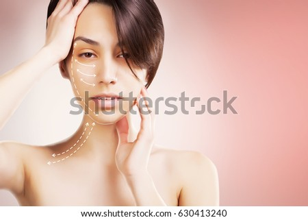 young asian anime looking model holds hands for product, marks on face #630413240