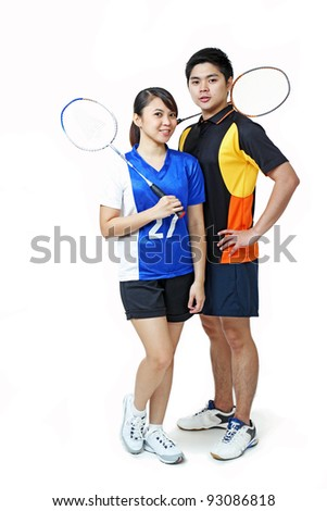 Young asian athletic couple isolated in solid background.
