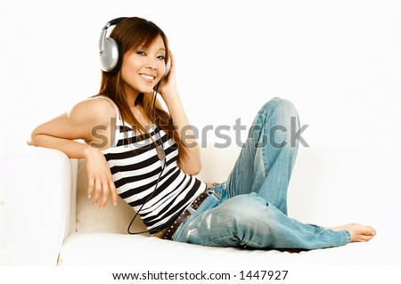 Young asian beautiful women is listening to the music