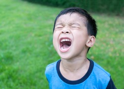 Young Asian boy are Angry on the park