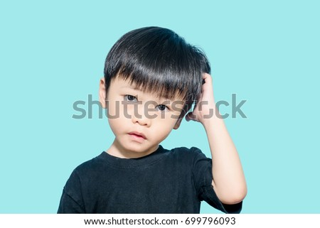 Young asian boy get confused and scratching his head, confusing concept #699796093