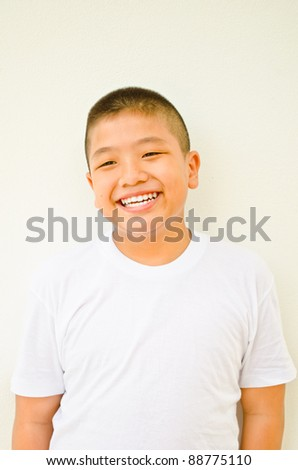 young asian boy smiling on white background #88775110