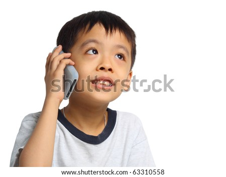 Young Asian boy talking to cell phone. Isolated on white background.