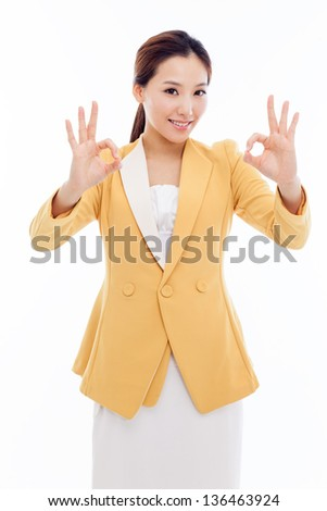 Young Asian business woman showing okay sign isolated on white background.