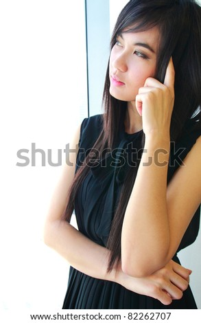 Young asian business woman thinking in the office