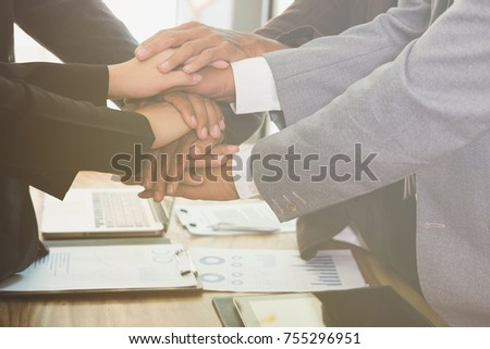 young asian businessman joining united hand, business team touching hands together after complete a deal in meeting - unity, harmony, teamwork, partnership, collaboration, corporate concept. #755296951