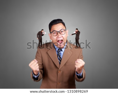 Young Asian businessman wearing suit shouting, angry expression. Sick of listening his own expression. Close up body portrait