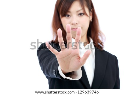Young asian businesswoman making stop sign