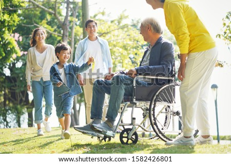 young asian couple and child visiting grandparents in nursing home