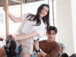 Young Asian couple having fun at an amusement park ride. Enjoyment in amusement park Concept.
