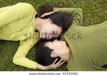 Young asian couple in love on the grass