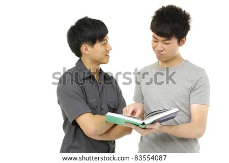 young asian couple student reading a book.