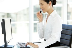 Young Asian customer service representative at workplace