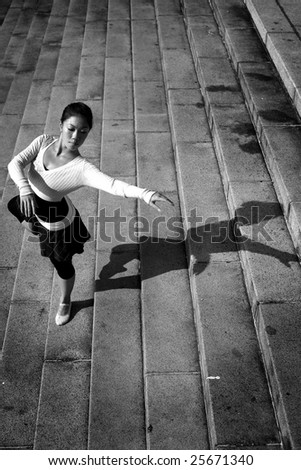 young asian female doing outdoor ballet