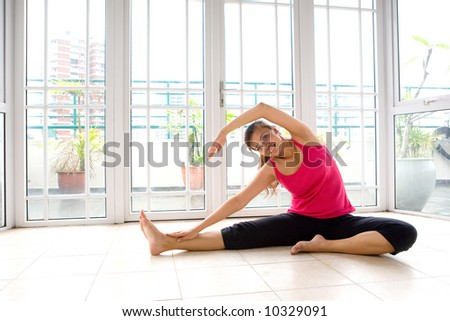 Young Asian female doing stretching exercise in a calm and peaceful environment